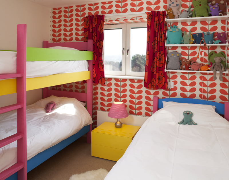 The colourfully decorated bunk room of The Old Granary, a holiday house in Rock, Cornwall