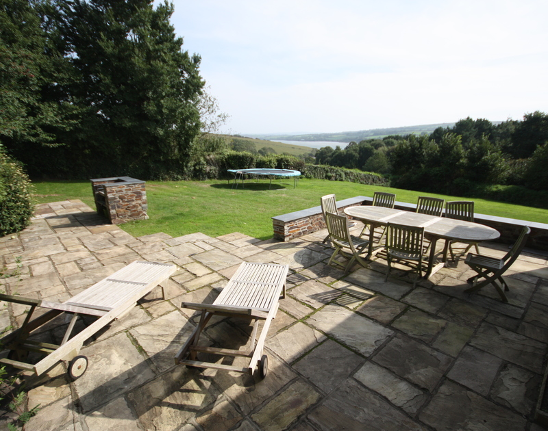 Spacious, furnished patio and sloping lawn at The Old Granary, a holiday house in Rock, Cornwall