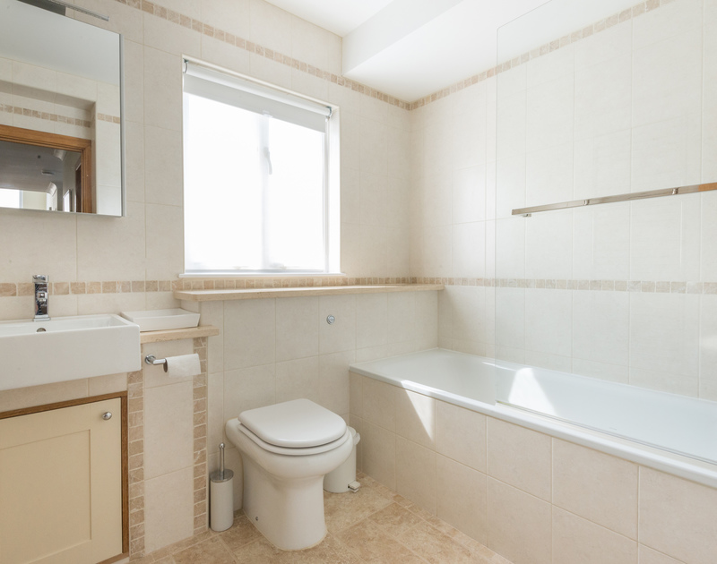 Family bathroom with a bath and shower combined at Ragleighs, a luxury holiday house close to the beach at Daymer Bay Cornwall.
