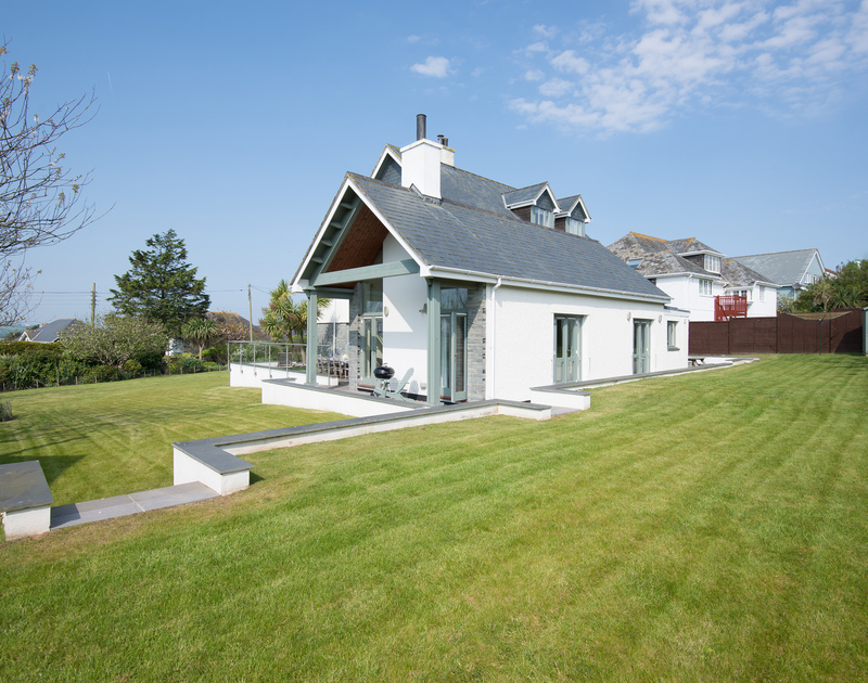Beautifully maintained and tiered lawns surround the house at Ragleighs, self catering luxury family accommodation above Daymer Bay in North Cornwall.