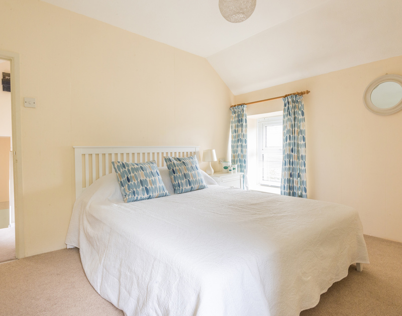 The comfortable double bedroom in self catering holiday property St Micheals in Rock, North Cornwall.