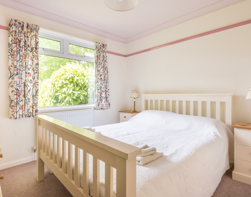 An attractive double bedroom at Brookfield, a secluded holiday house in Rock, Cornwall