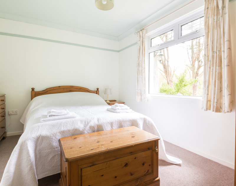 A light-filled double bedroom at Brookfield, a charming holiday house in Rock, Cornwall