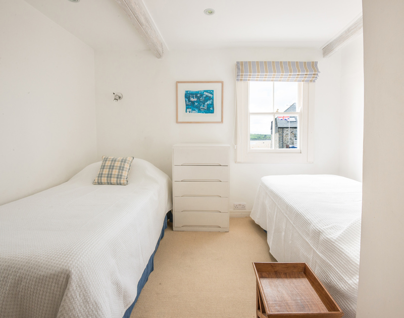 A twin bedroom with a lovely view of the estuary at 2 Quay Cottage, a superbly located holiday let in Rock, Cornwall
