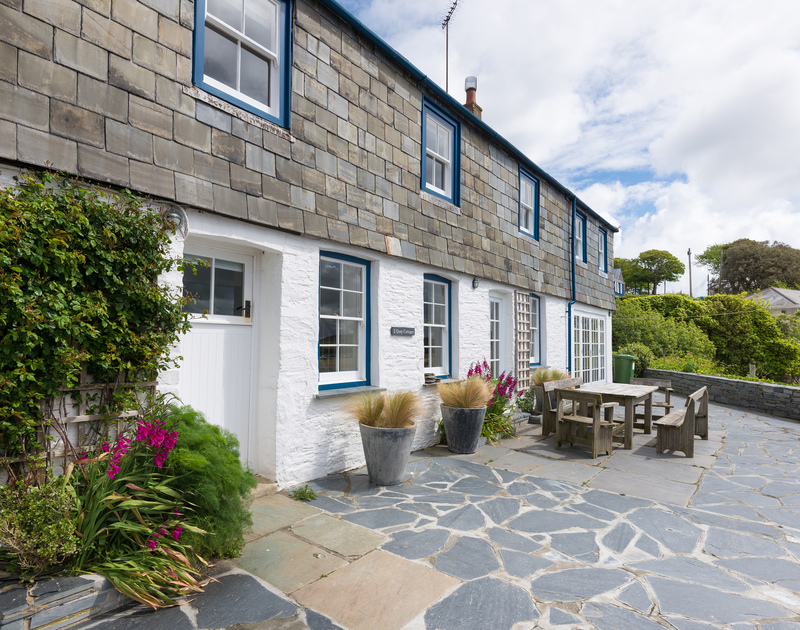 The spacious, south-facing slate garden area of 2 Quay Cottage, a charming holiday let in Rock, Cornwall