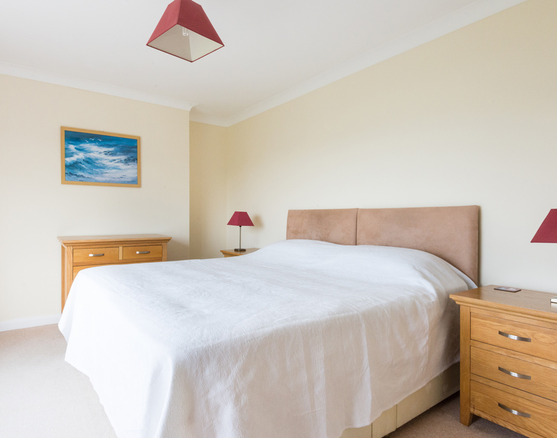 Kingsize bedroom with views of the garden and the sea beyond