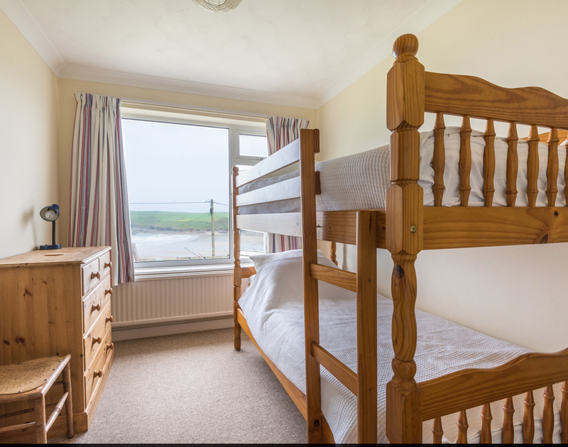 Bunk room with great sea views at Trevega, a holiday house to rent in Polzeath, Cornwall