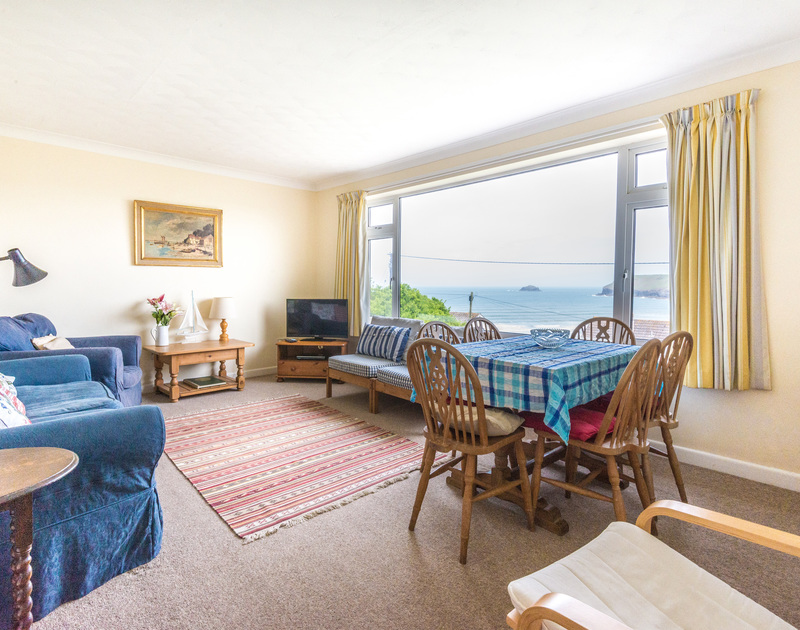 Comfy sitting room overlooking the garden and the sea at Trevega, a holiday rental in Polzeath, Cornwall