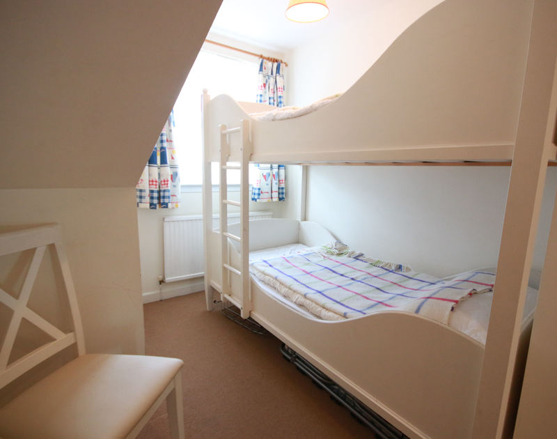The bunk bedroom in Slipway 12, a self catering holiday rental in Rock, North Cornwall.