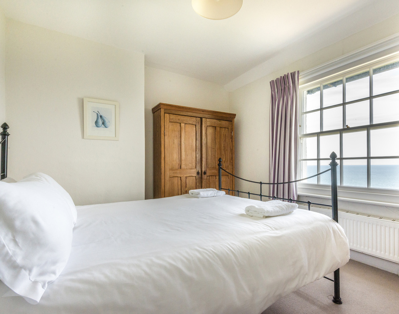 Spacious, bright  double bedroom facing the sea in Coastguard Cottage 3, a stunning clifftop holiday rental in Port Isaac, Cornwall.