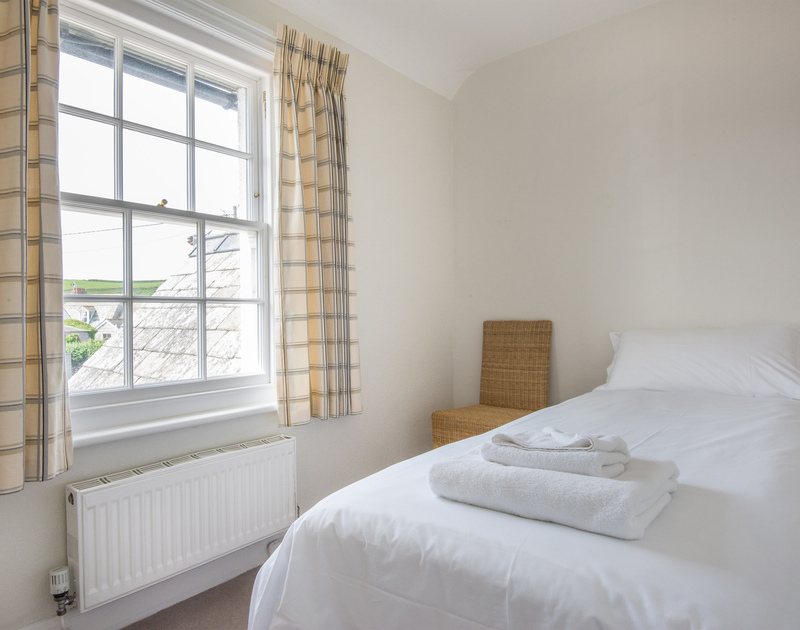Bright single bedroom with  village views in Coastguard Cottage 3, a stunning clifftop holiday house to rent in Port Isaac, Cornwall.