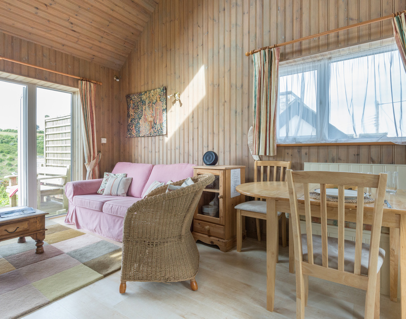 Open plan living/dining/kitchen in self catering holiday rental Cartway Cabin close to Port Isaac village and moments from the beach at Port Gaverne in North Cornwall.