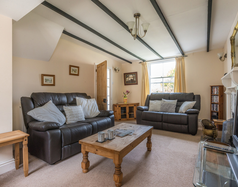 Comfortable and cosy sitting room with garden views at Morwenna, a holiday rental in Port Isaac, Cornwall