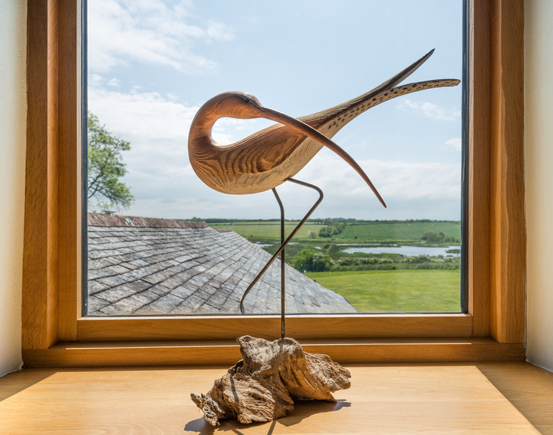 Bird sculpture detail from the upstairs sitting room with the fantastic view of the nature reserve in the background.