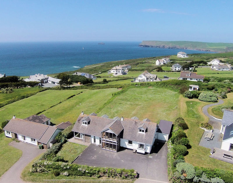 An aerial view of Penrhyn, a holiday house at Daymer Bay, Cornwall, showing the proximity of the coast and ocean.