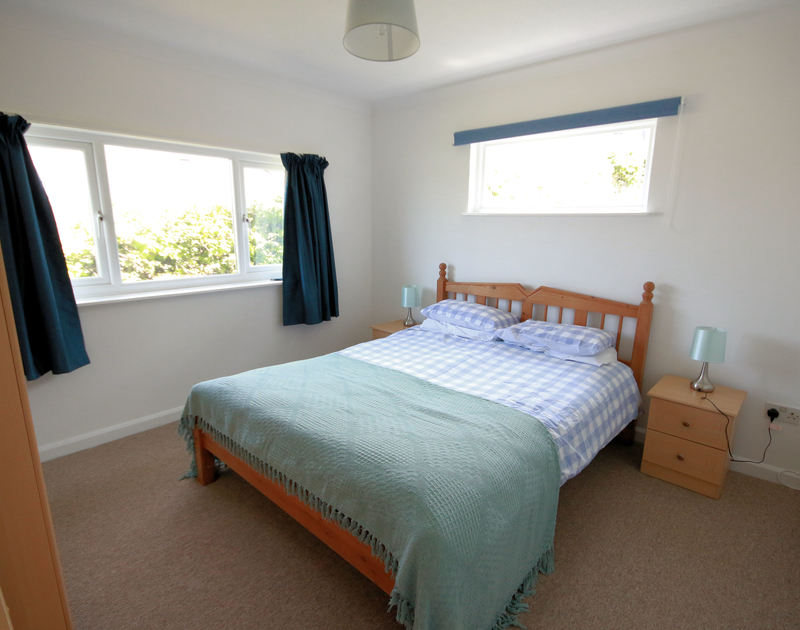 The king size bedroom in Gullsway;September Tide, a seaside holiday house to rent above the beach at Polzeath, north Cornwall.