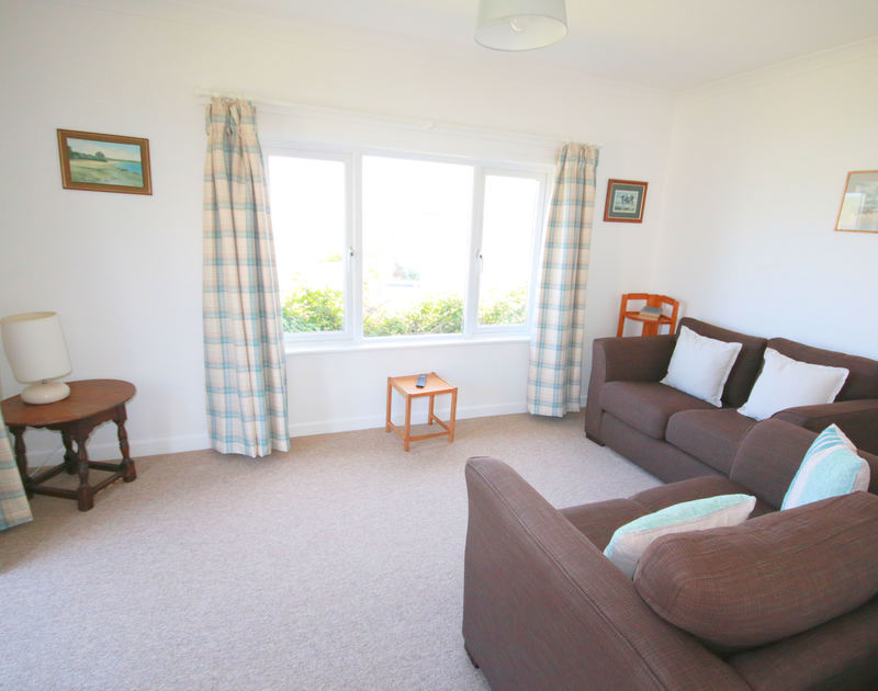 The lounge in Gullsway;September Tide, a self catering, pet friendly holiday bungalow in Polzeath, Cornwall.