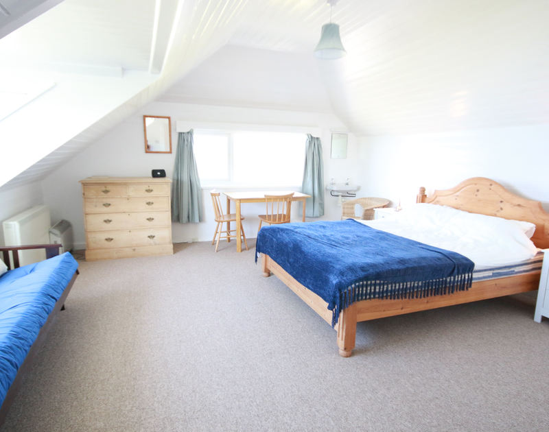 The spacious double bedroom of Gullsway: The Annexe, a first floor holiday apartment in Polzeath, Cornwall