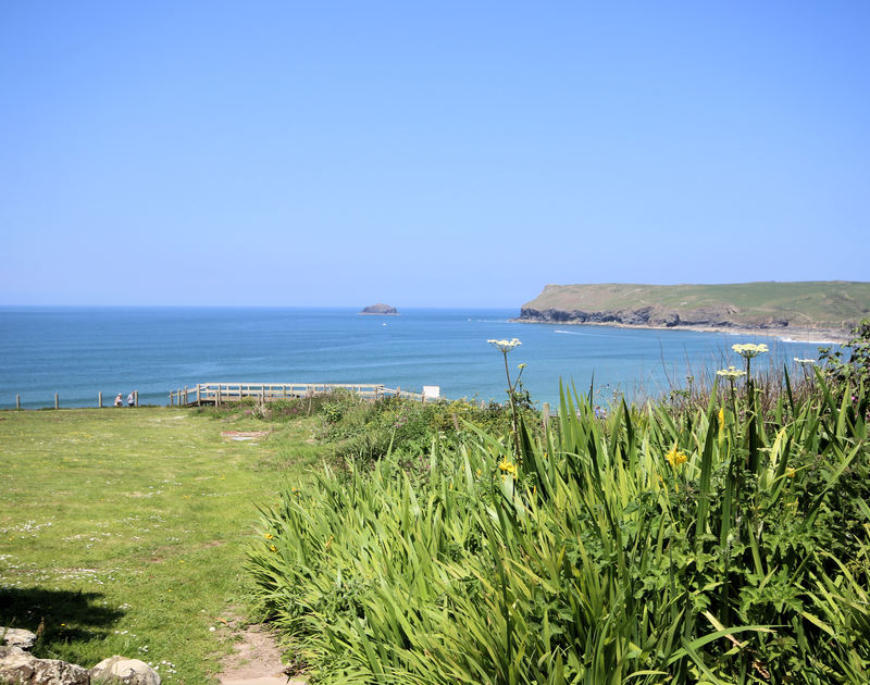 Fabulous seaviews from the large lawned garden of Gullsway: The Annexe, a holiday apartment in Polzeath, Cornwall