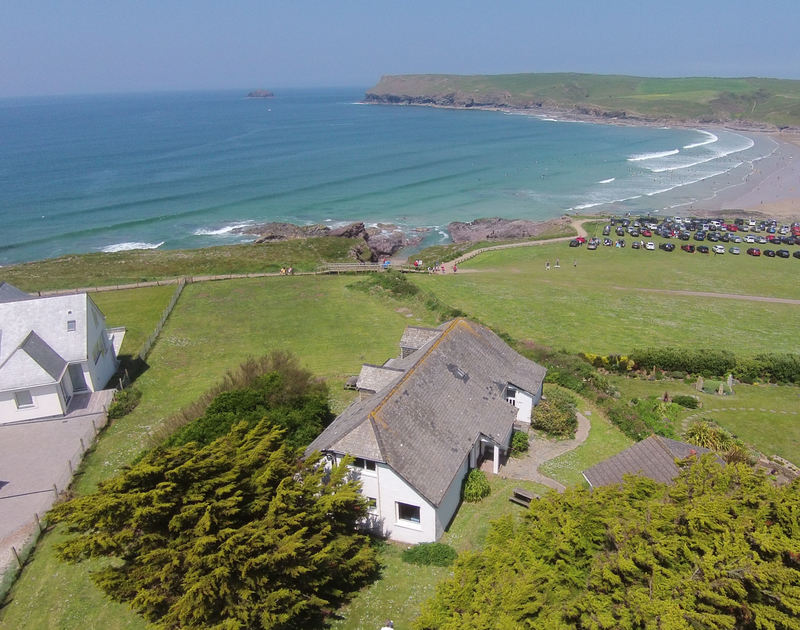 An aerial shot showing the fantastic clifftop setting of Gullsway;Sandpiper, a self catering holiday rental in Polzeath, Cornwall.