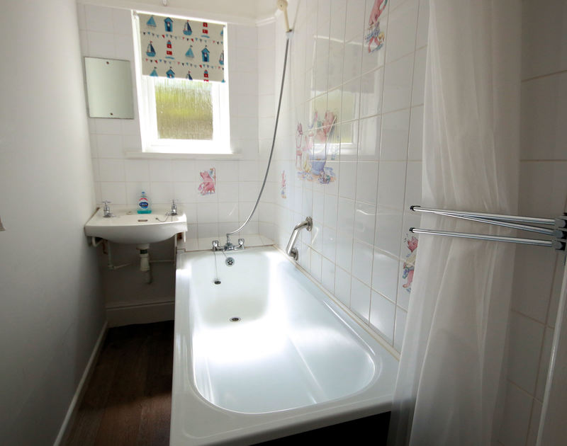 The bathroom in Gullsway;Sandpiper, a self catering holiday rental on the cliffs above Polzeath beach in north Cornwall.