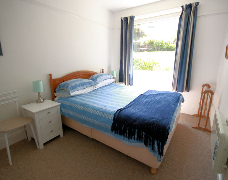 The bright double bedroom in Gullsway;Sandpiper, a self catering pet friendly holiday apartment in a fantastic setting above Polzeath Beach in North Cornwall.