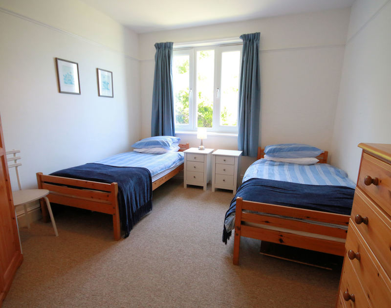 The twin bedroom in Gullsway;Sandpiper, a self catering holiday apartment in a seaside setting on the cliffs above Polzeath beach in Cornwall.