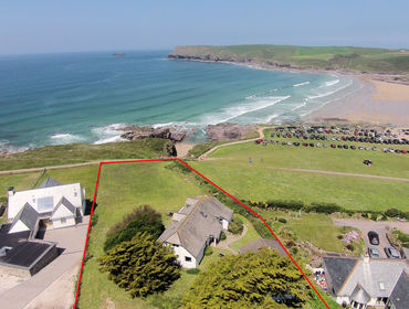 An aerial view of the fantastic location of Kittiwake, a self-catering holiday cottage in Polzeath, Cornwall