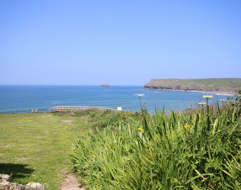 The large lawn at Kittiwake, a coastal self-catering holiday rental at Polzeath, Cornwall