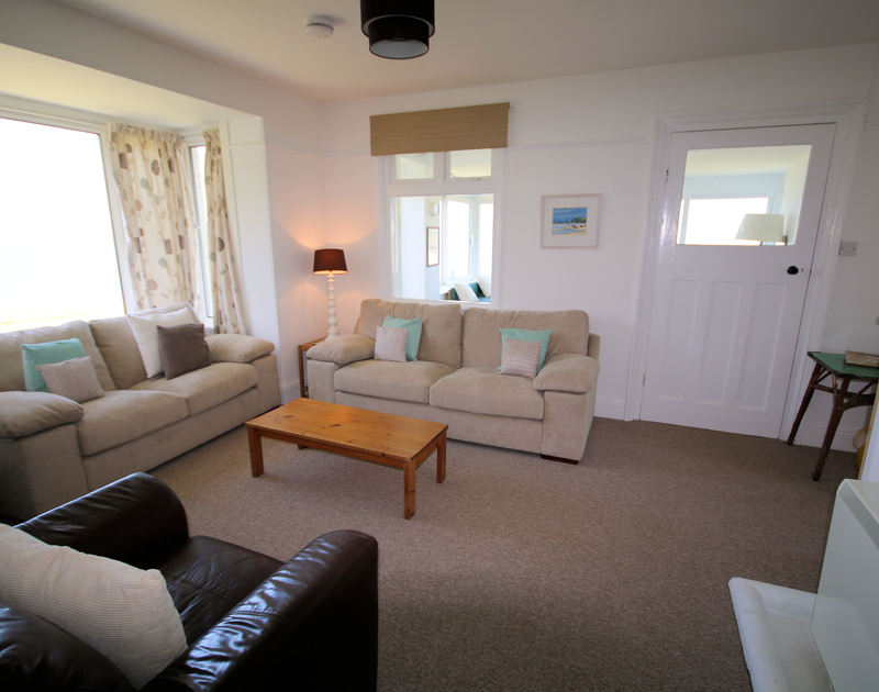 The sitting room of Kittiwake, a self-catering holiday cottage in Polzeath, Cornwall