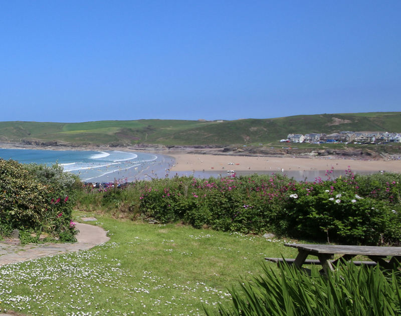 The pretty garden and sea views from Gullsway;September Tide, a self catering, pet friendly holiday rental in Polzeath north  Cornwall.