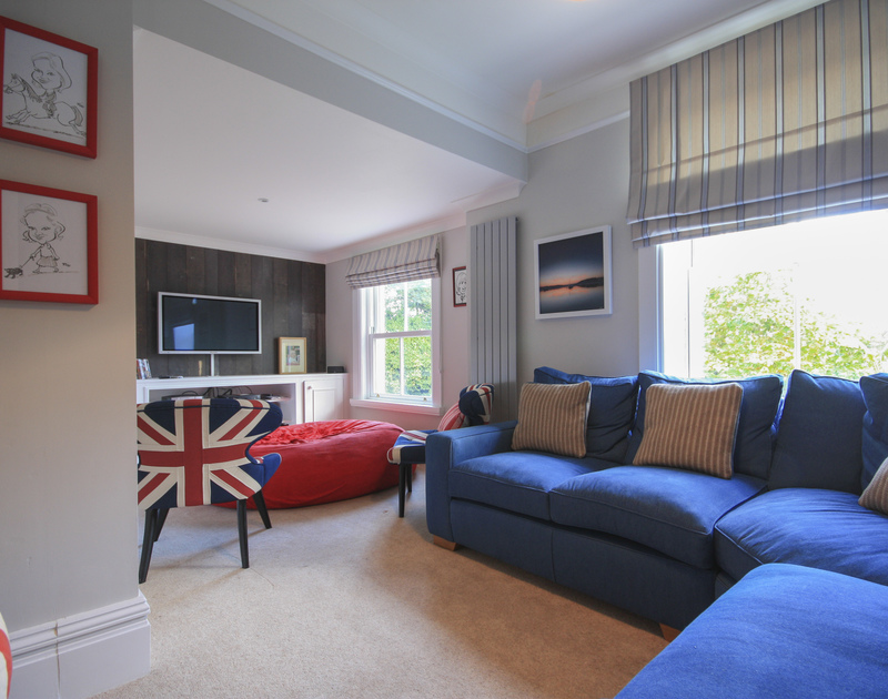 A choice of comfy seating in the snug TV room at The Haven, a holiday rental near Daymer Bay, Cornwall