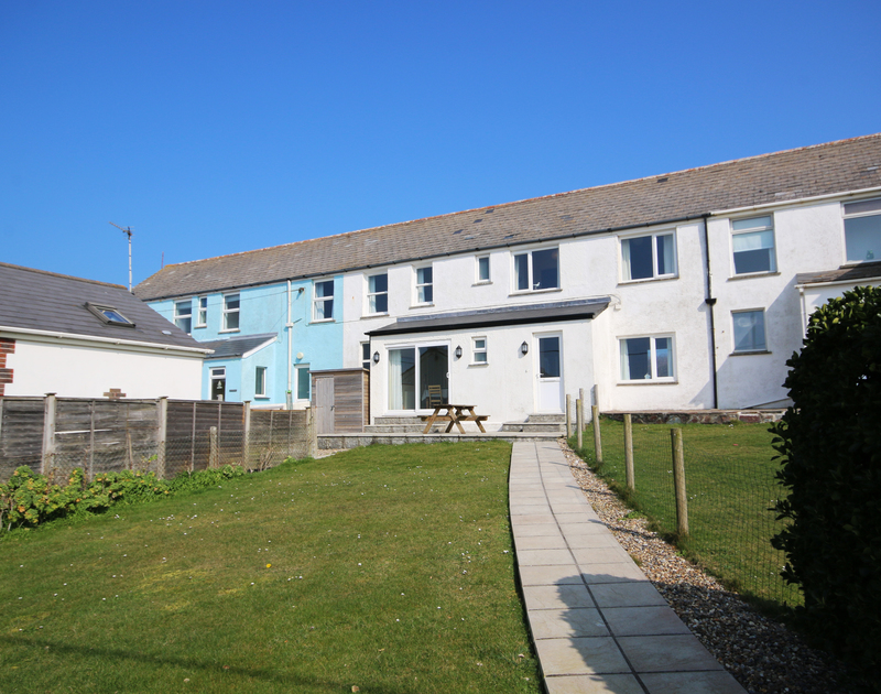 The exterior of The Holiday House, a self catering holiday rental in New Polzeath, North Cornwall.
