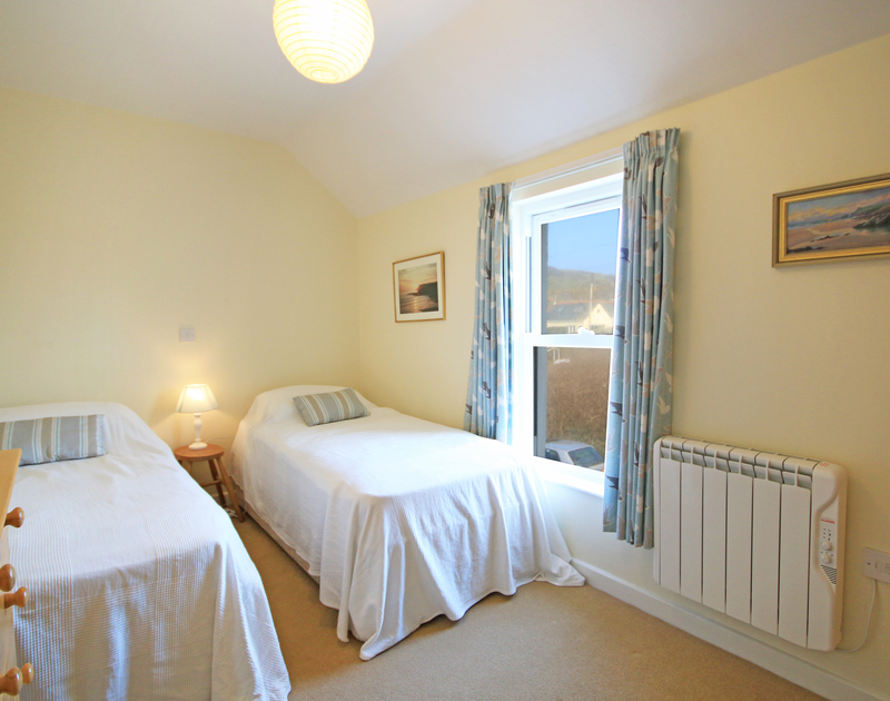 The second of two twin bedrooms in The Holiday House, a self catering holiday rental in New Polzeath, North Cornwall.