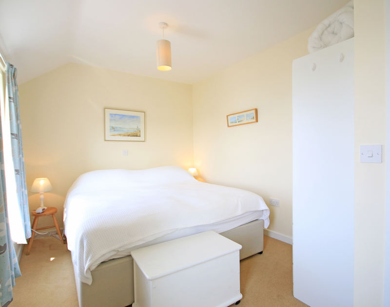 The master bedroom in The Holiday House, a self catering holiday rental in New Polzeath, on the North Cornish Coast.