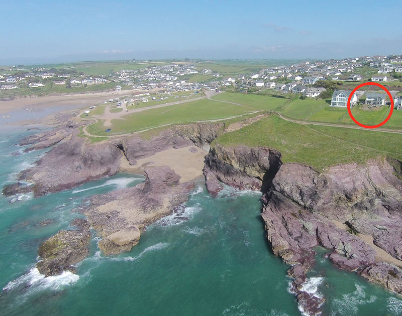 An aerial view of Treleven Cottage, a luxury self catering holiday rental set on the cliff top at Polzeath in North Cornwall.