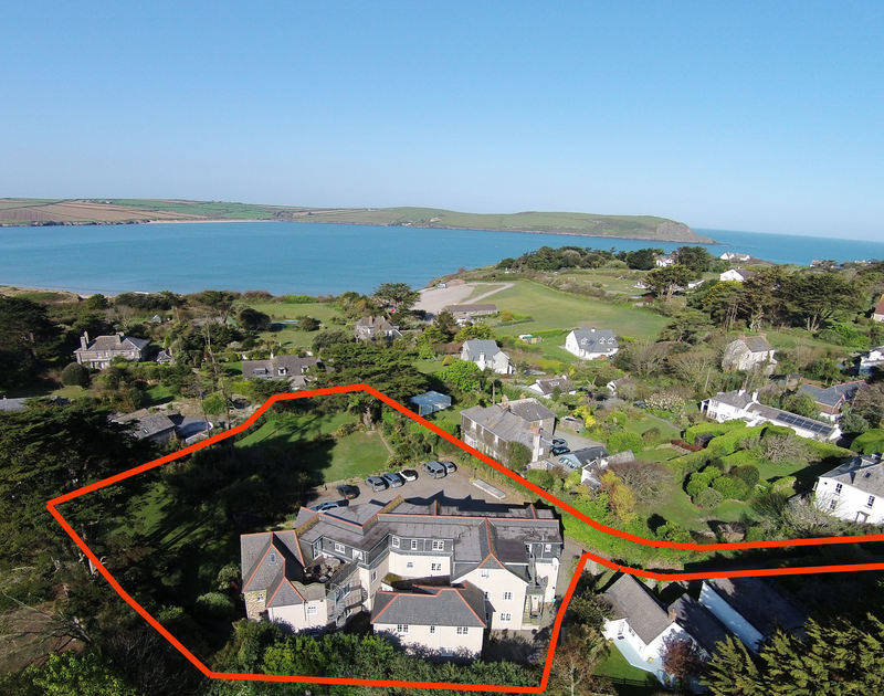 An aerial view of the Bodare, self-catering holiday apartments at Daymer Bay, Cornwall, with its large grounds and car park.