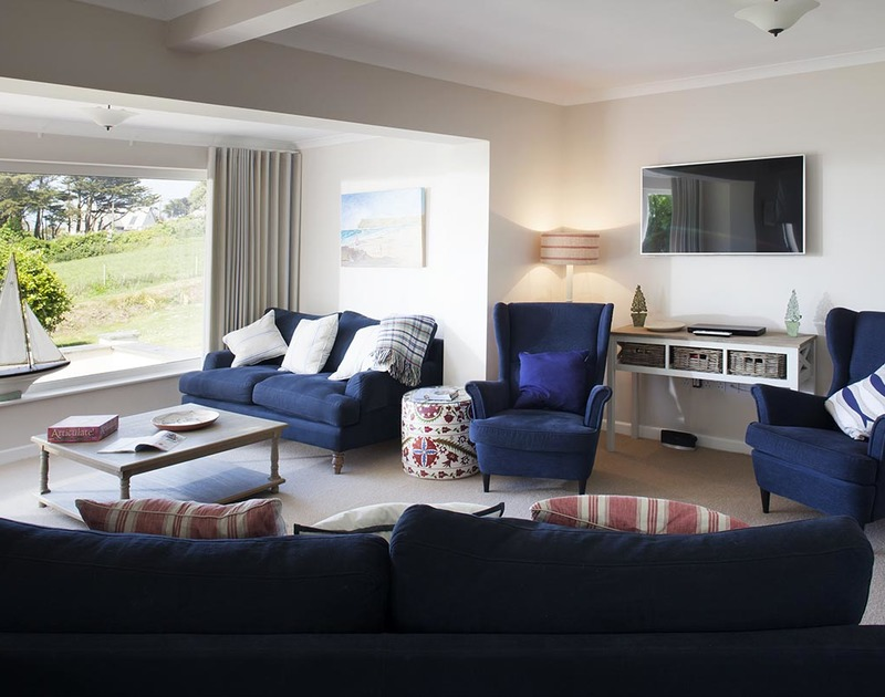Spread out across the spacious sofas and armchairs in Bay View Cottage.