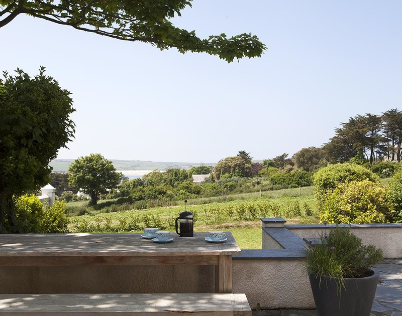 Sun or shade and stunning views from the slate terrace at Bay View Cottage.