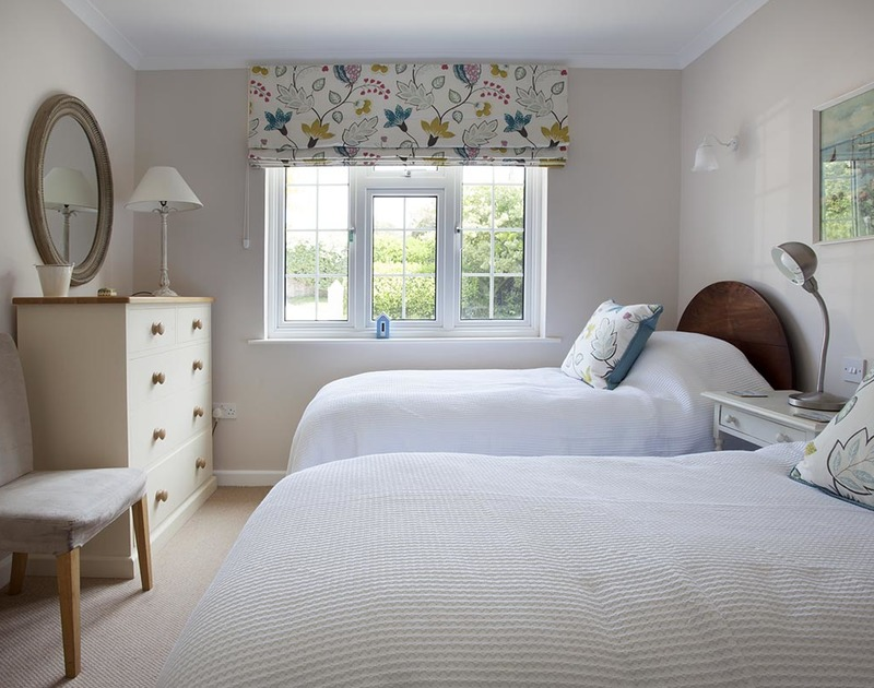 The light and bright downstairs twin bedroom at Bay View Cottage in Daymer Bay.