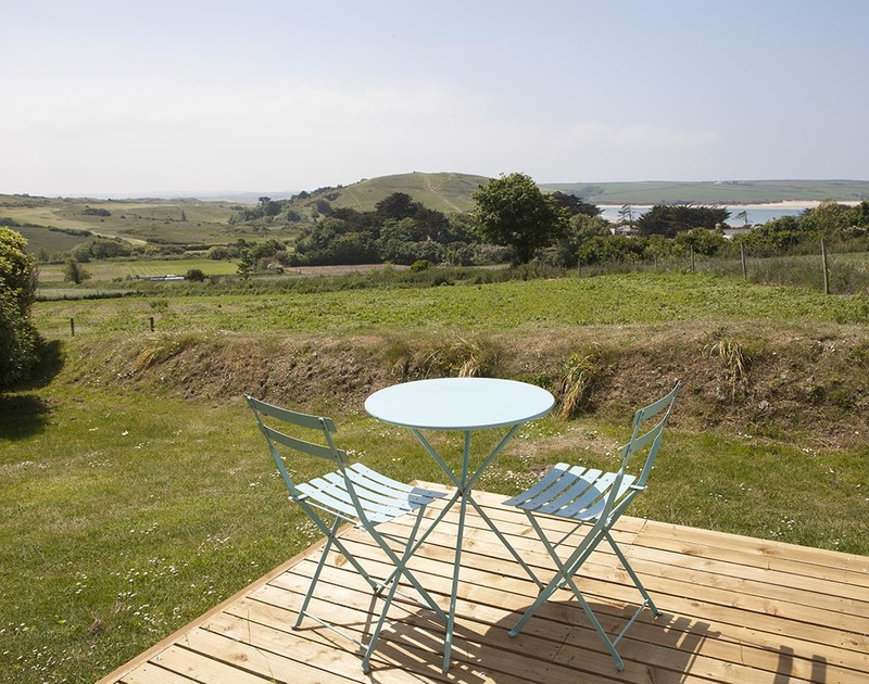 The perfect and uninterrupted views down the garden at Bay View Cottage of Brea Hill, across the St Enodoc golf course alongside the Camel Estuary.