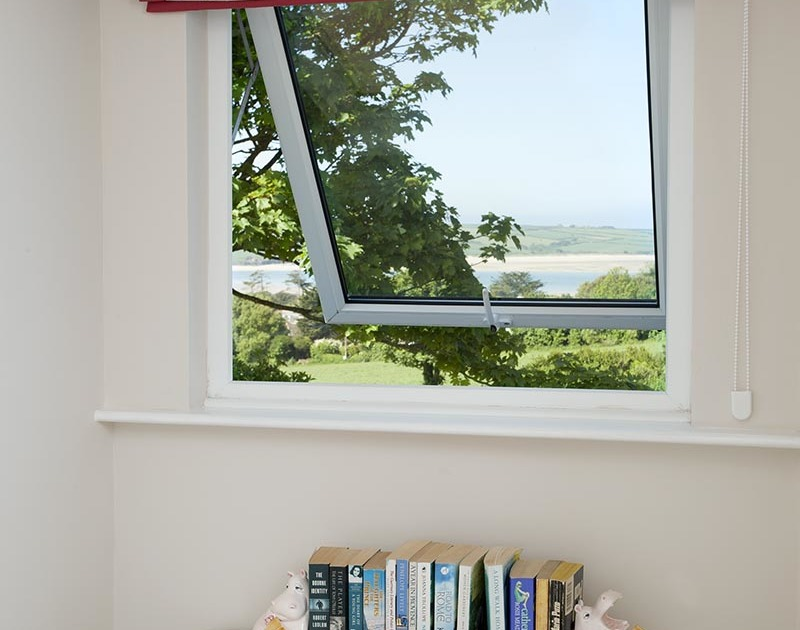 Enjoy the stunning Camel Estuary views over Daymer Bay from one of the bedroom windows at Bay View Cottage, a self catering holiday house to rent in North Cornwall.