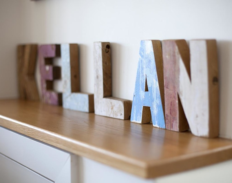 Driftwood-style artwork at Kellan, a luxury holiday house in Polzeath, Cornwall, with wooden cut out letters spelling Kellan.