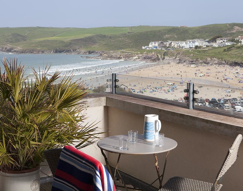 Sea and beach views from the balcony at Kellan, a superb self-catering holiday rental in Polzeath, Cornwall