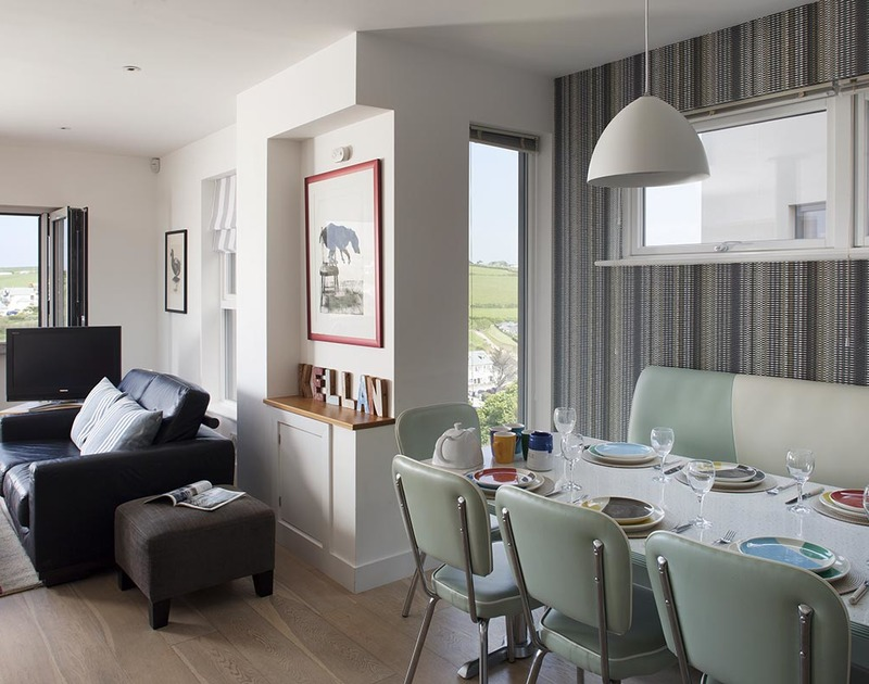 Open-plan dining area at Kellan, a stunning self-catering holiday house in Polzeath, Cornwall