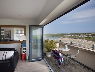 Gorgeous seaviews from the living room and balcony at Kellan, a luxury self-catering holiday house in Polzeath, Cornwall.