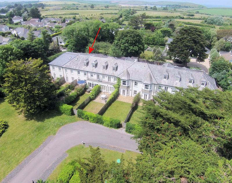 An aerial view of Lowenna Manor 3, a well-located holiday house in Rock, Cornwall, with its enclosed garden.