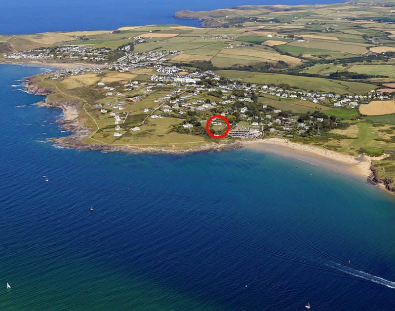 High aerial photograph of Daymer Bay showing the location of the coastal holiday retreat Sandy Lodge and it's private swimming pool set just above Daymer Bay, Cornwall.