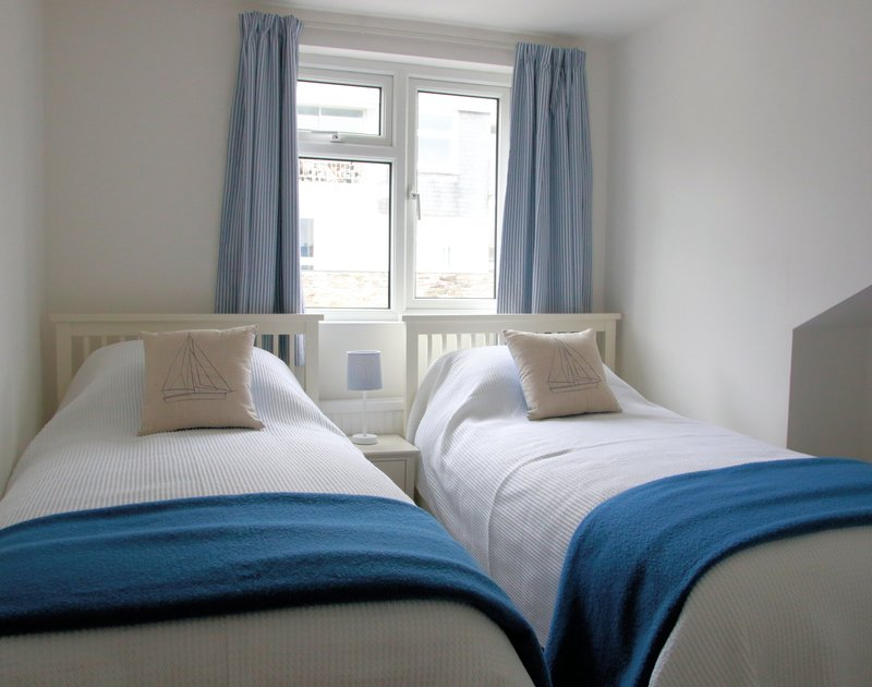 Cosy stylish twin bedroom at Slipway 10, with matching furnishings