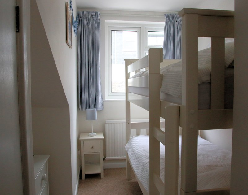 The bunk room of Slipway 10, a holiday cottage in Rock, perfect for families with children.